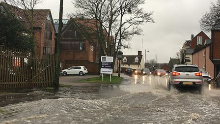 Traffic built up in Woodbridge while drivers tried to navigate through flood water. Picture: MELISSA