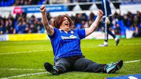 Jennifer Jo Lees celebrates scoring three penalties in a fans half-time penalty shoot out competitio