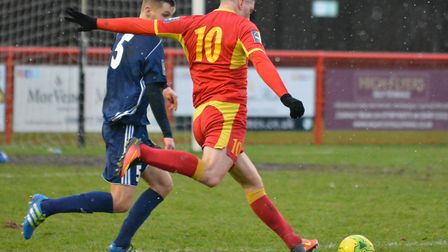 Needham's John Sands about to fire off a shot against Hendon. Photo: BEN POOLEY