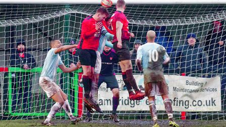 GOAL Ed Rolph climbs highest to head home the Histon equaliser against Felixstowe on Saturday. Photo