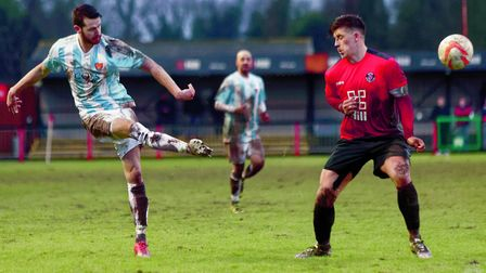 Seasiders' top scorer Miles Powell shoots past Histon's Max York but hits the cross bar. Photo: STAN