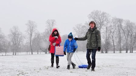 Vrinda, Pablo and David Read James enjoying a walk in the snow in Christchurch Park. Picture: SARAH