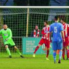 The Felixstowe defensive wall is worried as Connor Ingram's free kick goes just wide for Wroxham. Pi