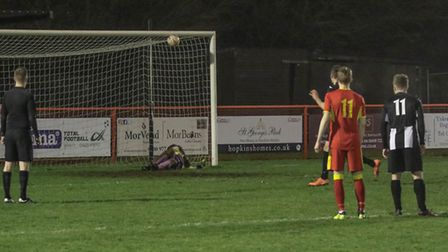 Finlay Shorten makes a great penalty save for Needham Reserves. Picture: PAUL LEECH
