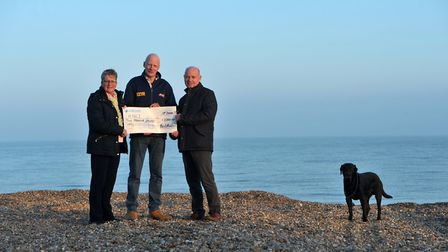 Neil and Gill Mason from the Sibton White Horse present a cheque for �2,000 to Aldeburgh RNLI coxswa