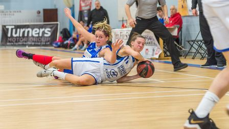 Ipswich's Danni Cazey wins the loose ball contest against Derbyshire. Picture: PAVEL KRICKA