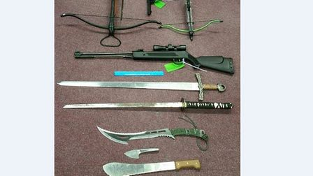 Two crossbows, an air rifle, two swords, three knives, and a revolver were found by police at a prop