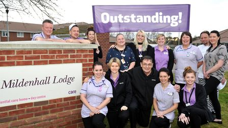 Staff at Mildenhall Lodge celebrate its outstanding CQC rating. Picture: LUCY TAYLOR
