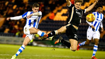 Nathan Smith tries to get in the way of a second-half shot by Sammie Szmodics during the 1-1 draw at
