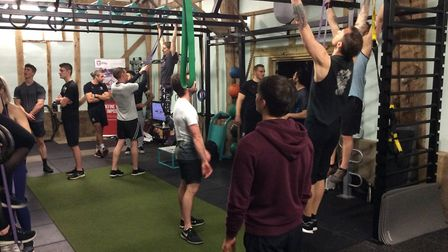 Students at the School of Calisthenics workshop at EXF Fitness practise their pull-up variations. Pi