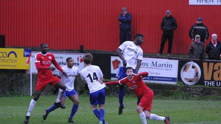 Braintree's Christian Frimpong clears his lines with a towering header. Picture: JON WEAVER
