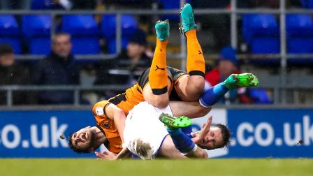 Stephen Gleeson and Ruben Neves hit the ground after a full-bloodied 50/50 clash from which the Town