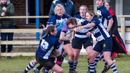 Woodbridge Amazons skipper Claire Brickley rumbles through tackles against Chelmsford. Picture: SIMO