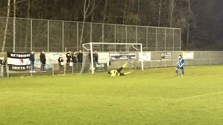 Heybridge fans behind the goal as their side go on the attack at Ware, keeper Garry Malone saving a
