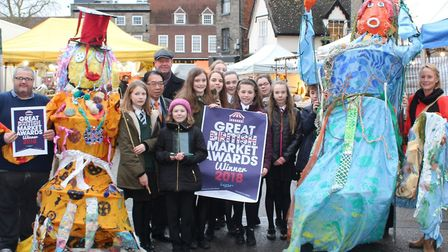 Pupils and market traders celebrate the national award in Bury St Edmunds. Picture: ST EDMUNDSBURY B