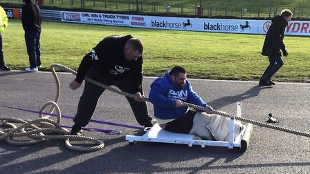 Chris Rix set two world records at an exhibition event for Britain's Disabled Strongman at Brands Ha