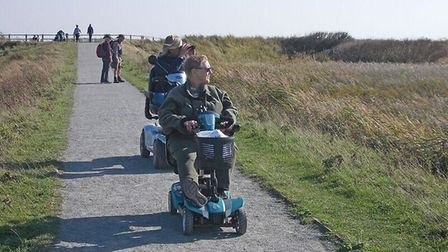 Participants take part in Waveney Bird Club's mobility scooter birdwatch at RSPB Minsmere, a fundrai