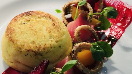 Goat's cheese souffle with pickled beets and crispy shallots.
