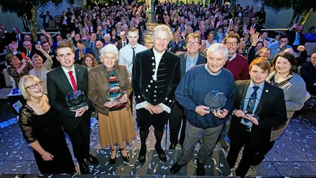 The winners with the High Sheriff, Geoffrey Probert, at the glittering event presented by BBC Radio