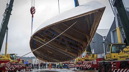 The rollover of the largest hull ever to be built by Ipswich-based Spirit Yachts. Picture: Mike Bow