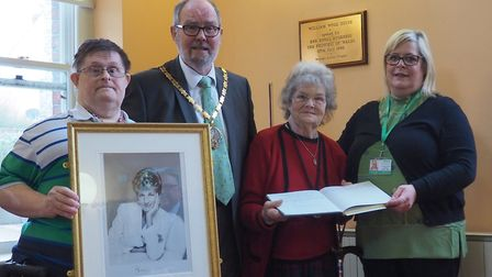The presentation of the photograph and visitor's book takes place in William Wood House, in front of