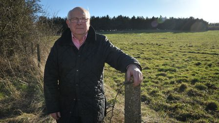 Claydon Parish council chairman Chris Studd at the site where a plan for 300 homes was turned down o