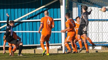 Jake Green's powerful header puts Woodbridge one up against Holland FC. Picture: PAUL LEECH
