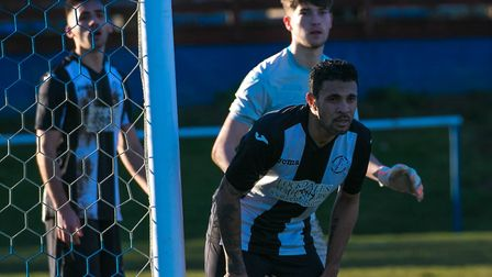 Woodbridge Town's Carlos Edwards and keeper Alfie Stronge prepare to defend a Holland FC corner. Pic