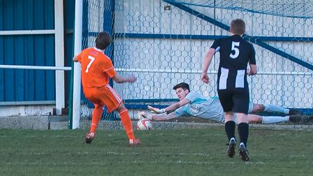 Woodbridge Town's Alfie Stronge makes a fine penalty save in their clash with Holland FC. Picture: P