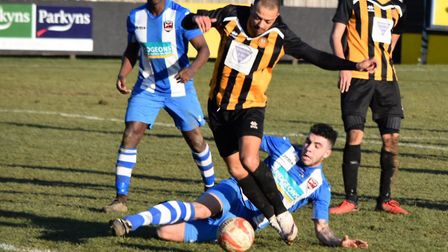 Stow's Anton Clarke looks for a way through the Saffron defence. Picture: DAVID WALKER