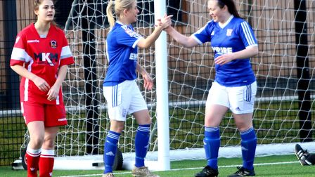 Ipswich Ladies skipper Amanda Crump, left, enjoys one of her strikes with Miagh Downey. Picture: ROS