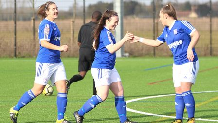 Ipswich Town Ladies players Miagh Downey and Lindsey Cooper congratulate Jordan Arnoup. Picture: ROS