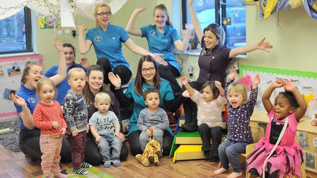Staff and children at Meadow Brook Playcare celebrate their success. Picture: SARAH LUCY BROWN