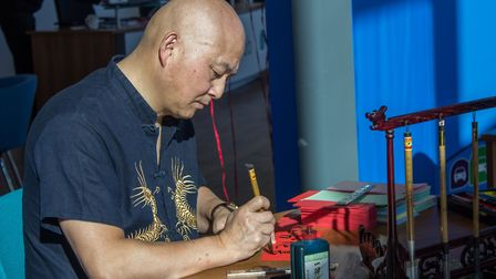Chinese calligraphy at the opening of Evans Halshaw's new Car Store in Ipswich. Picture: Evans Hal
