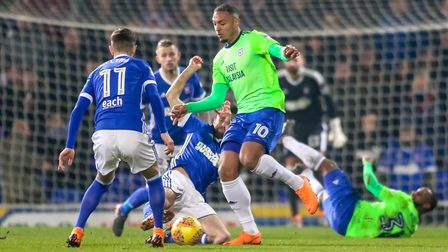 Cole Skuse battles for the ball with Kenneth Zohore. Picture: STEVE WALLER
