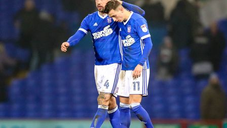 Luke Chambers with Bersant Celina after the final whistle. Picture: Steve Waller www.stephenwa