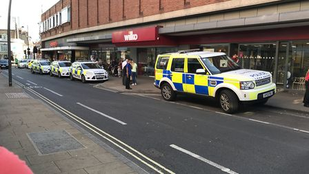 A row of police cars outside Wilko in Ipswich. PIcture: CONTRIBUTED