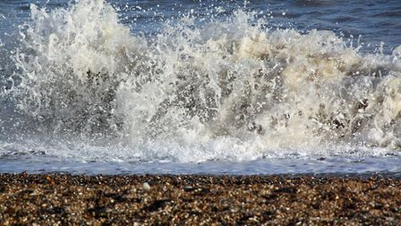 A small wave crashing onto the beach at Minsmere Haven. Picture: DAVID LAMMING
