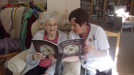 Staff and residents worked on the 70-page charity cookbook together. Picture: HEALTHCARE HOMES