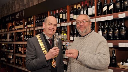 Mayor of Felixstowe Nick Barber and John Greenwold making a toast at the opening of The Wine Boutiqu