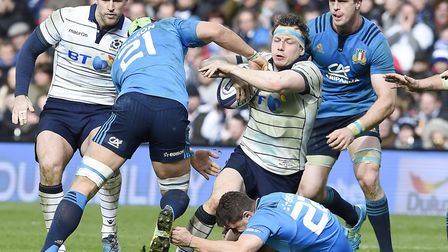 Hamish Watson of Scotland is tackled by Francesco Minto (21) and Marcello Violi of Italy with Tim Vi