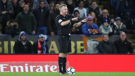 Referee Jonathan Moss consulting VAR before giving Leicester City's second goal to Kelechi Iheanacho