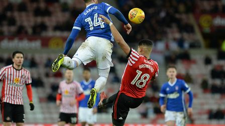 Joe Garner launches himself to beat Tyias Browning to the ball at Sunderland Picture Pagepix