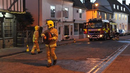 Firefighters investigate the scene in Sudbury. Picture: SARAH LUCY BROWN