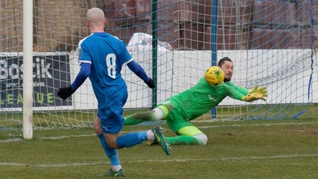 GOAL Leiston's Chris Henderson watches Lucas Cavagnari in the Worthing goal fumble his shot into th