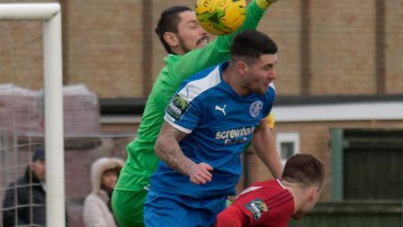 Leiston's Jack Ainsley is sandwiched between the Worthing keeper and a defender. Photo: PAUL VOLLER