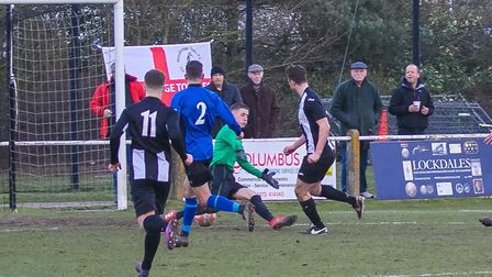 Woodbridge Town's Mark Ray scores for his side at home to Little Oakley. Photo: PAUL LEECH.