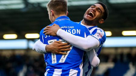 Ben Stevenson is congratulated by team-mate Mikael Mandron after the midfielder had scored the openi