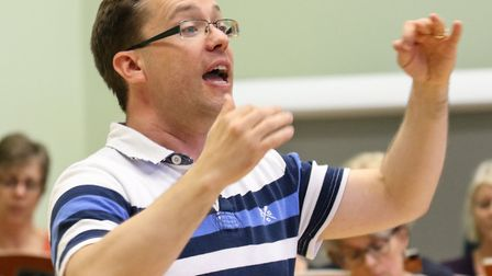 Ipswich Choral Society music director Robin Walker in rehearsal. Picture: DAVID ROBINSON