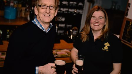 Mike Kirkham from Our Bury St Edmunds and Heather Warren raise a glass to the Ale Trail at Oakes Bar